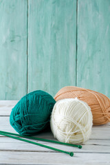 knitting yarn hanks on wooden surface