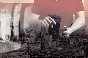 double exposure of designer man hand using smart phon for mobile