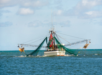 Shrimp fishing boat sailing on ocean in Florida