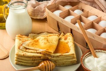 ingredients for making pancakes and pancakes