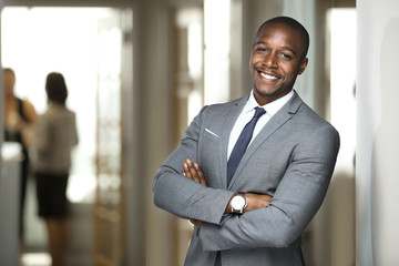Smiling boss ceo at office work place portrait of worker in suit and tie looking handsome