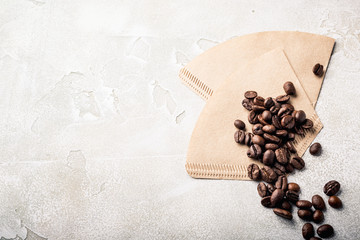 Filters and coffee beans, retro style toned, copy space, top view.