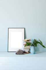 blue room interior style with frame book and vase of flowers