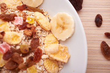 flakes with dried fruit, granola on the plate
