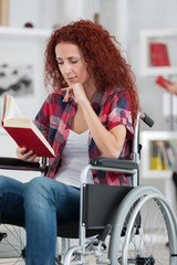 young handicaped woman reading
