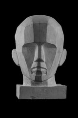 plaster statue of a human skull and head with an angular outline graphic.
