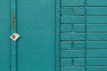 Turquoise Painted Brick and Wood Wall