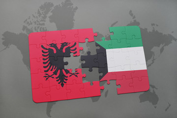 puzzle with the national flag of albania and kuwait on a world map