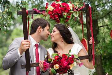 Bride and groom holding photo frame with wedding decoration