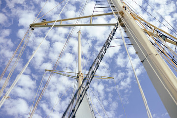 Yachting sail mast detail on sunny sky background