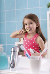 Child brushing her teeth.