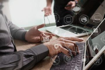 Designer Businessman hand using smart phone,mobile payments onli