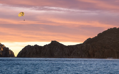 Hang Gliding over the ocean at sunset in Cabo San Lucas