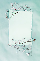 Spring, floral background with white paper and white lobelia