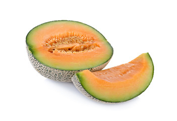 half and portion cut ripe cantaloupe on a white background