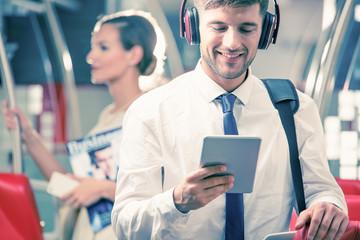 Man with headphones in train