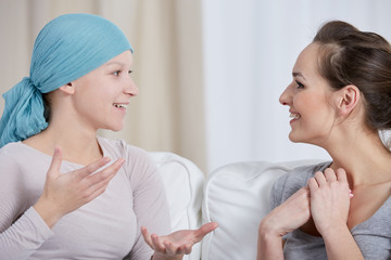 Young cancer woman with friend