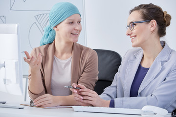 Woman after chemo at work