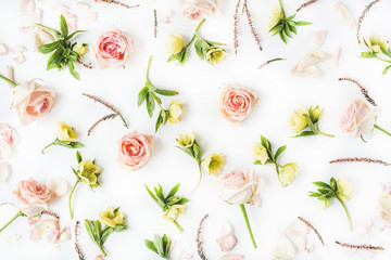 Floral texture. Pink roses and yellow flowers on white background. Flat lay, top view