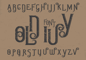 Vector alphabet set. Capital grunge letters with decorative flourishes in the Art Nouveau style. Black font on brown background.