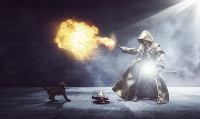Wizard conjuring a fireball while the cat is scared