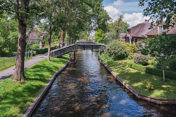 View of a number of bridges across the canal in the Dutch town Giethoorn in The Netherlands