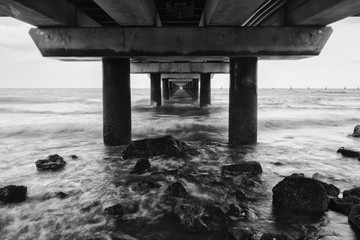 Black and white image of Shorncliffe Pier in Queensland, Australia.
