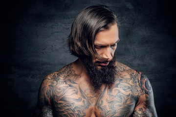Portrait of a  man with tattooed body.