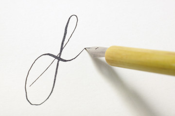 Nib pen tip writing small letter f in a spencerian style