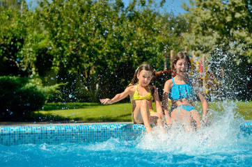 Summer fitness, kids in swimming pool have fun and splash in water, children on family vacation