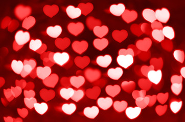 Red and white hearts bokeh as background