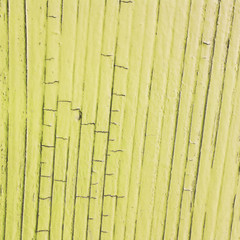 cracked wooden plank, yellow  background