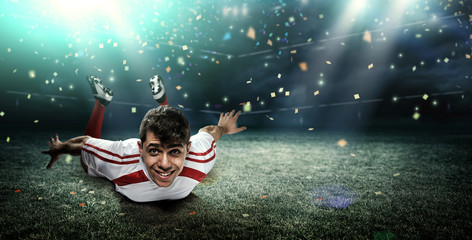 Fototapete - Football player in the stadium, joy of goal