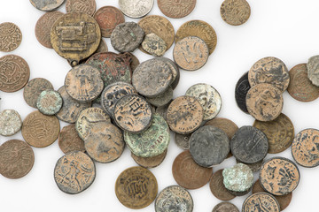 Collection of old vintage coins isolated on white..