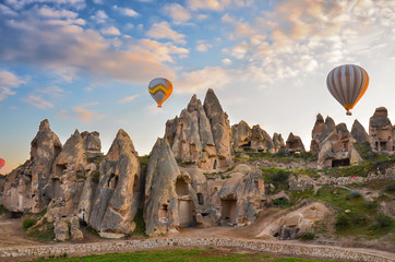 Hot air balloons flying over spectacular Cappadocia, Turkey. Sunrise
