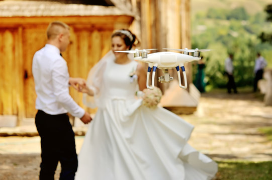 dron filming a wedding couple