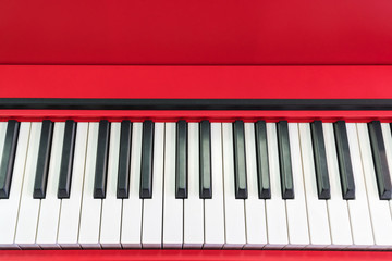 Black and white keys piano red close-up with space for text