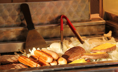 A Collection of Fast Food Cooking on an Outdoor Grill.