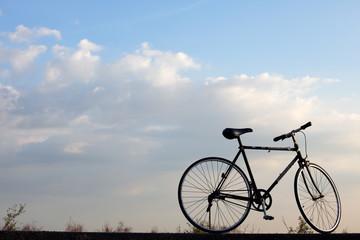 landscape of vintage bicycle against blue sky.