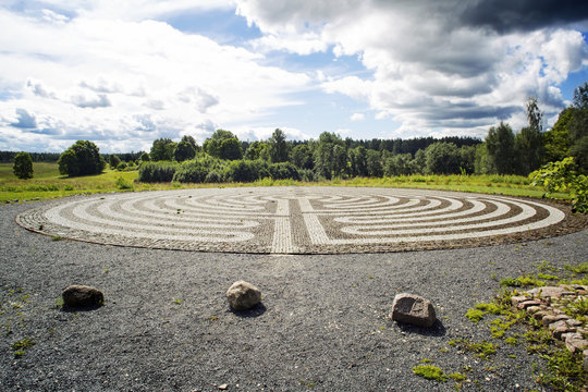Gothic labyrinth from black and white cobble-stones in the field. Europe. Letonia. Symbol of a new way, clarification