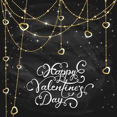 Golden hearts and Valentines lettering on black chalkboard backg