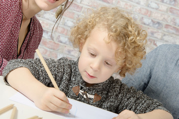 little blond boy drawing