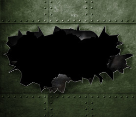 big hole in military green metal armor background