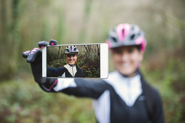 Selfie of smiling female mountain biker