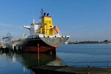 Product Tanker in operations at the Oil Terminal of Lorient, Brittany France.