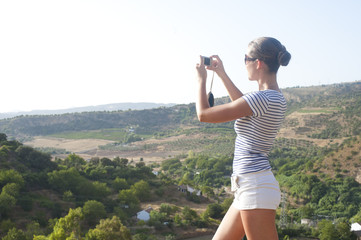 Young, pretty woman on summer holiday in Ronda, Spain, Andalusia
