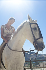 Young, pretty woman on summer holiday in Ronda, horse back ridin
