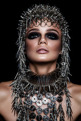 Foto op Plexiglas People High fashion beauty model with metallic headwear and dark makeup and blue eyes on black background