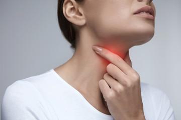 Sore Throat. Closeup Beautiful Woman Hands And Neck. Throat Pain