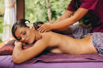 Young woman enjoying a massage at spa